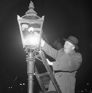 Man lighting a gas light (gaslight)